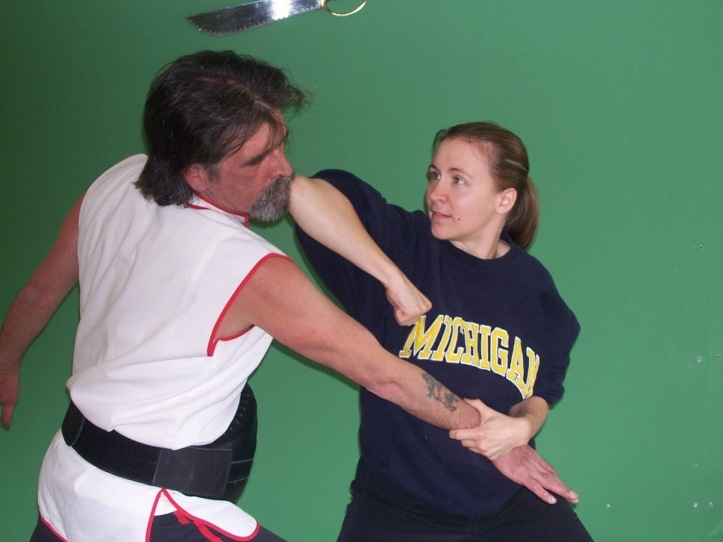 """Elbows strikes are delivered from various angles to all parts of an opponent vital to head, body, arms and legs."" Quote and Photo source : www.mplsplumblossom.net"