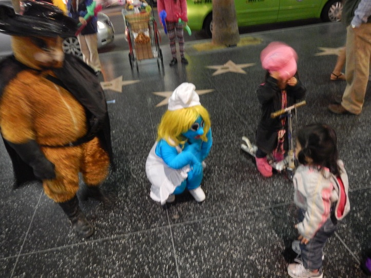 Munchkin meets the mini-stars at Hollywood Walk of Fame last month